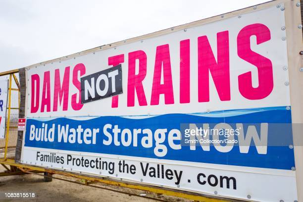 Sign in the San Joaquin Valley of California protesting water politics and the construction of high speed rail lines, with text reading Dams Not...