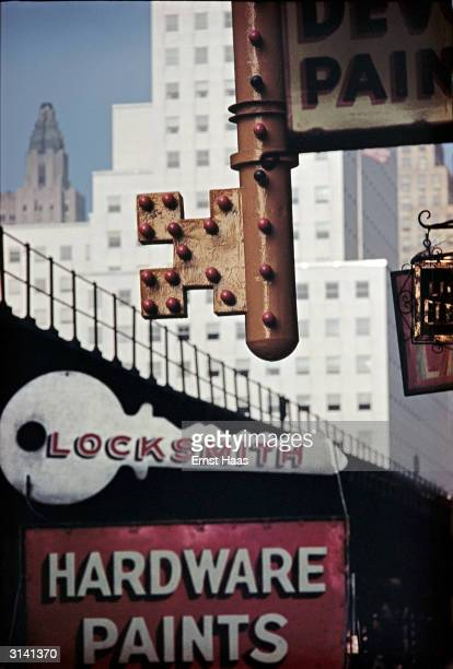 A sign in the shape of a giant key over a locksmith's hardware store in New York City Colour Photography book