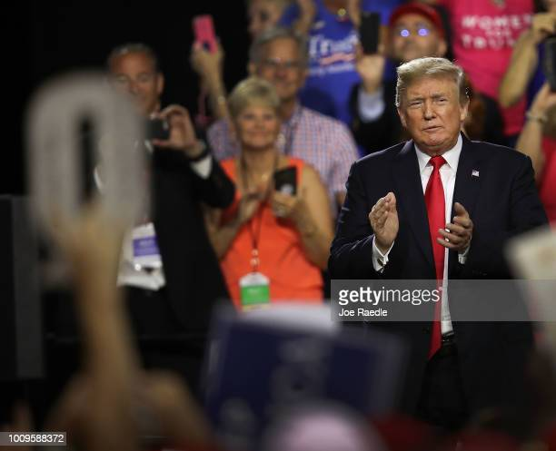 A sign in the shape of a Q is held up as President Donald Trump attends his Make America Great Again Rally being held in the Florida State Fair...