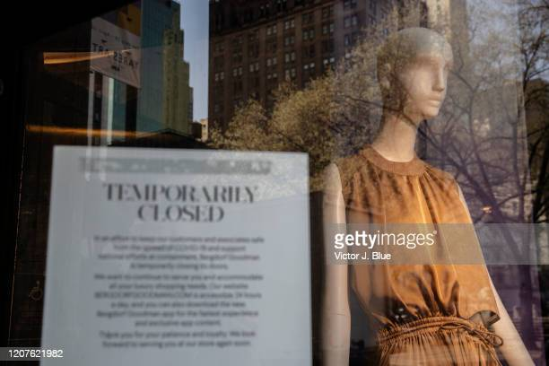 A sign in the window announces the closing of the store at Bergdorf Goodman Department store as it sits closed in the wake of the Coronavirus COVID19...