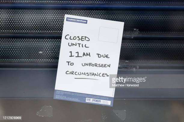 A sign in the window of a Carphone Warehouse store in central Cardiff on March 17 2020 in Cardiff Wales The phone retailer has announced the closure...