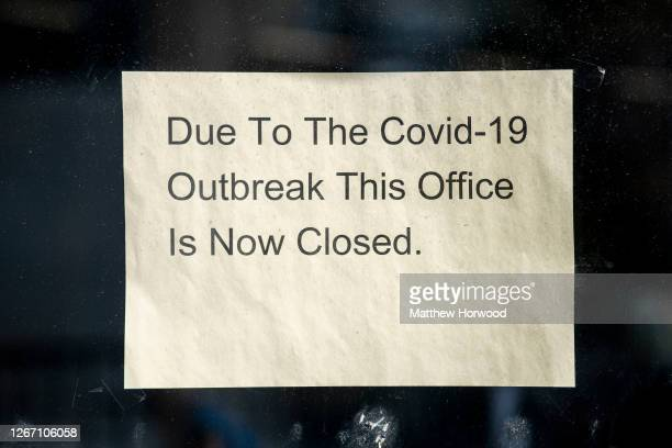 Sign in the window of a closed office on August 18, 2020 in Bargoed, Wales. The Office For National Statistics reported the UK's GDP fell By 20.4%...