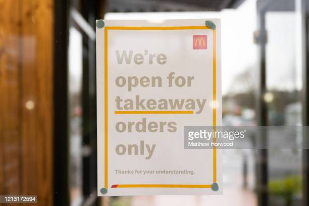 A sign in the window of a McDonald's restaurant on March 18 2020 in Cardiff Wales The fast food company has announced its stores will be open only...