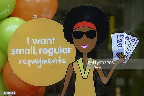 Sign in the window of a payday loans store in Dalston on October 3, 2013 in London, England. Payday loan stores are to face tougher regulations after...