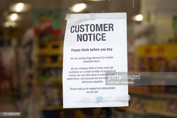 A sign in the window of a Poundland store warning customers to shop responsibly due to the surge in demand for certain items on March 17 2020 in...
