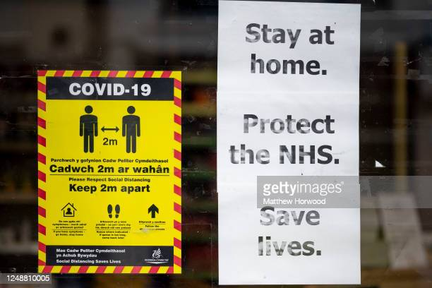 """Sign in the window of a small business says """"stay at home, protect the NHS, save lives"""" on June 10, 2020 in Aberdare, United Kingdom. The Welsh..."""