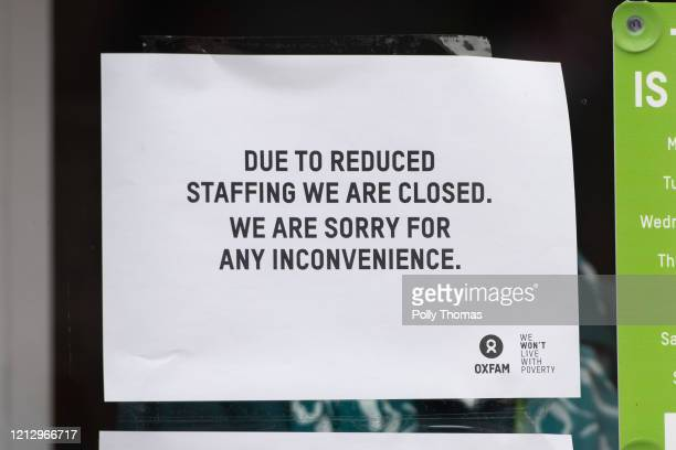 Sign in the window of an Oxfam charity shop informing of its closure due to reduced staffing on March 17, 2020 in Cardiff, United Kingdom. Boris...