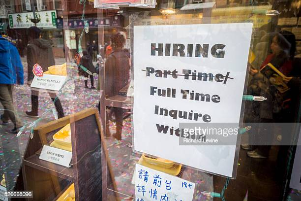 A sign in the window of bakery in Chinatown in in New York advises potential job applicants of the opportunities available seen on Saturday February...