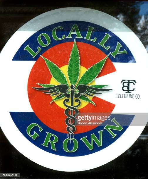 A sign in the window of one of several medical and recreational marijuana retail stores in Telluride Colorado advertises its locally grown products