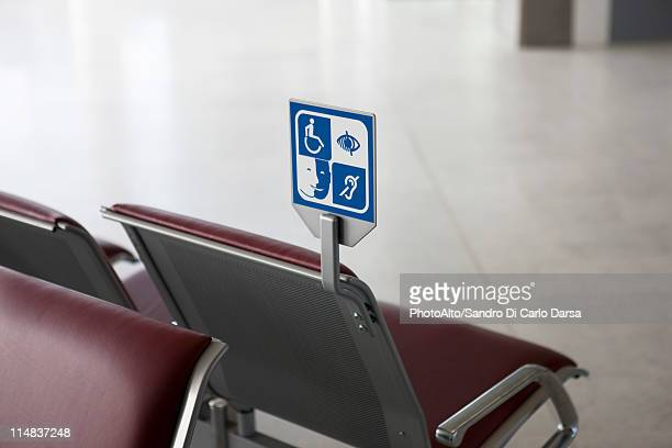 Sign in waiting area designating seating for persons with disabilities
