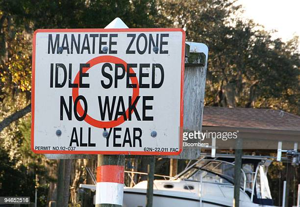 Sign indicates a manatee zone as a warning to boaters to keep a slow speed at Crystal River, Florida, in December, 2006.