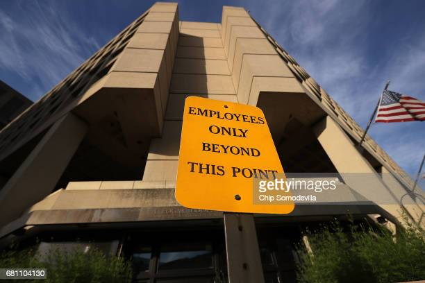 A sign indicates an entrance for employees only at the Federal Bureau of Investigation Edgar J Hoover Building May 9 2017 in Washington DC On the...