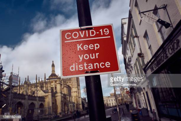 Sign indicates keeping a safe distance on November 10, 2020 in Cambridge, England. England entered a second national coronavirus lockdown on 5th...