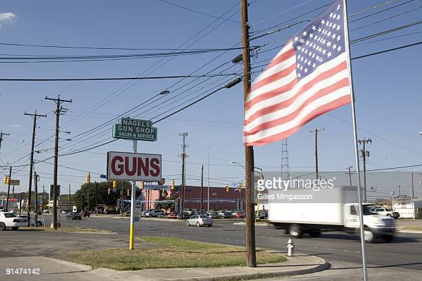 A sign indicates Nagel's Gun Shop one of the 6700 gun dealers located near the 2000 miles long USMexico border where guns and semiautomatics weapons...