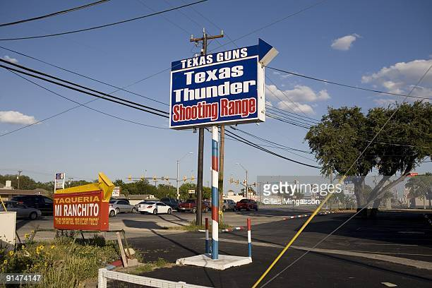 A sign indicates Texas Gun one of the 6700 gun dealers located near the 2000 miles long USMexico border where Gina Brewer the store's manager insists...
