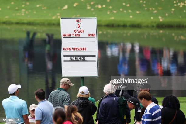A sign indicates that play is suspended during the Par 3 Contest prior to the start of the 2017 Masters Tournament at Augusta National Golf Club on...