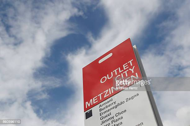 A sign indicates the direction to other clothing retail stores at Outletcity Metzingen on August 19 2016 in Metzingen Germany Metzingen is famous for...
