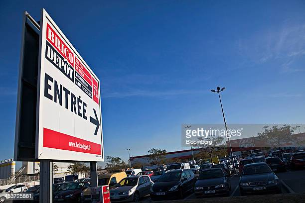 A sign indicates the direction to the entrance of a Brico Depot SAS building and electrical products store operated by Kingfisher Plc at the Odysseum...
