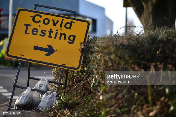 Sign indicates the entrance to a drive-in COVID-19 testing facility set up in Rochester, south east England on November 24, 2020. - British Prime...