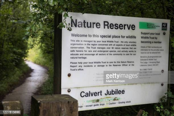 Sign indicates the entrance to Calvert Jubilee Nature Reserve on 27 July 2020 in Calvert, United Kingdom. On 22nd July, the Berks, Bucks and Oxon...