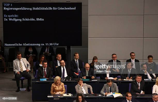 A sign indicates the ongoing speech of German Finance Minister Wolfgang Schaeuble during a meeting of the German federal parliament or Bundestag on...