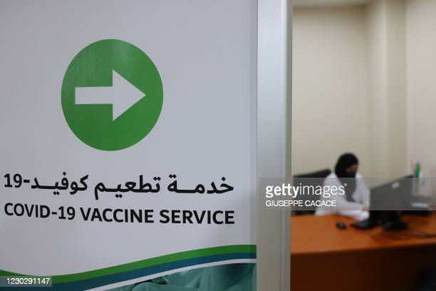 Sign indicates the way to the coronavirus vaccination service at al-Barsha Health Centre in the Gulf Emirate of Dubai on December 24, 2020.