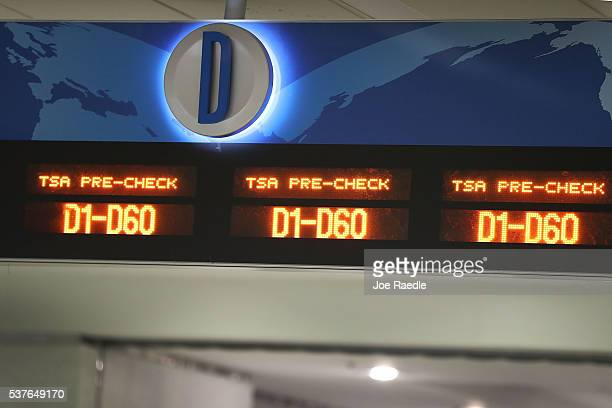 A sign indicates the way to the TSA PreCheck security point at Miami International Airport on June 2 2016 in Miami Florida As the busy summer travel...