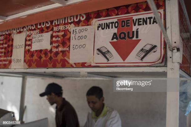 A sign indicating that credit cards are accepted is displayed at a hot dog stand in the Chacao district of Caracas Venezuela on Wednesday Dec 6 2017...