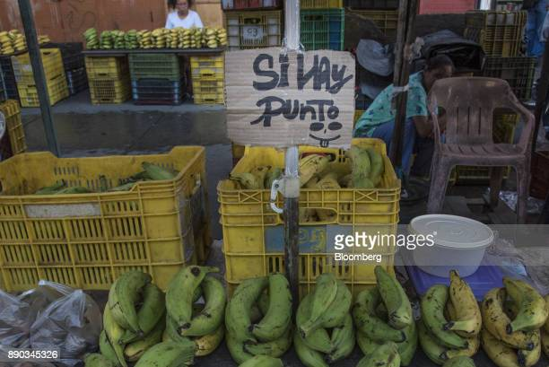 A sign indicating that credit cards are accepted is displayed at a banana stand in Petare Miranda state Venezuela on Wednesday Dec 6 2017 Venezuelan...