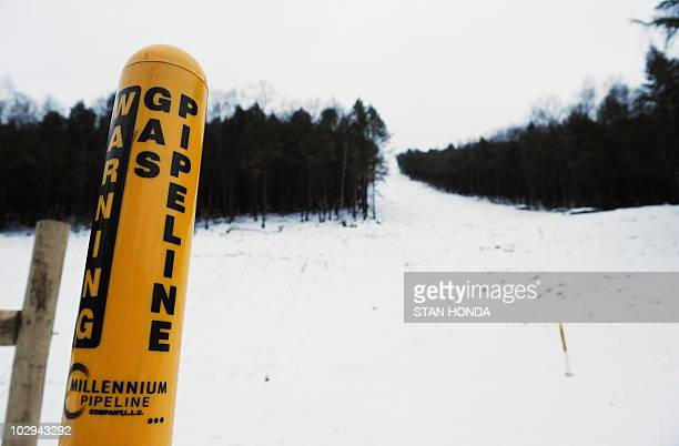 A sign indicating the location of the Millenium Pipeline buried under a cut in the forest December 14 2009 in Hancock New York about 140 miles...