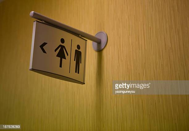 A sign indicating where the lavatory is
