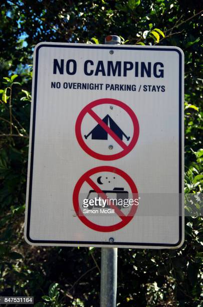 Sign indicting no camping or parking overnight in a car park at Front Beach, Trial Bay, Arakoon, New South Wales, Australia