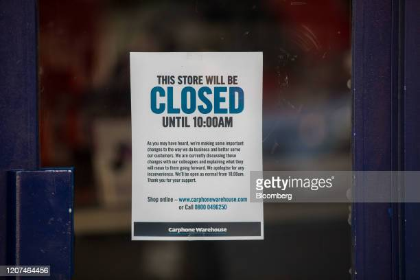 A sign informing customers of a late opening is stuck to the window of a Carphone Warehouse operated by Dixons Carphone Plc in London UK on Tuesday...