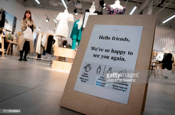 A sign informing customers on measurements to prevent from being infected stands in a shop in Field's Shopping Center in Copenhagen Denmark after the...