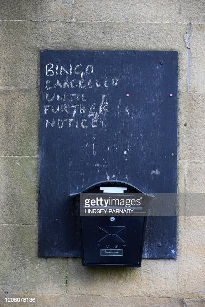A sign informing residents that bingo has been cancelled because of coronavirus is seen at the local community centre in the village of Eyam in...