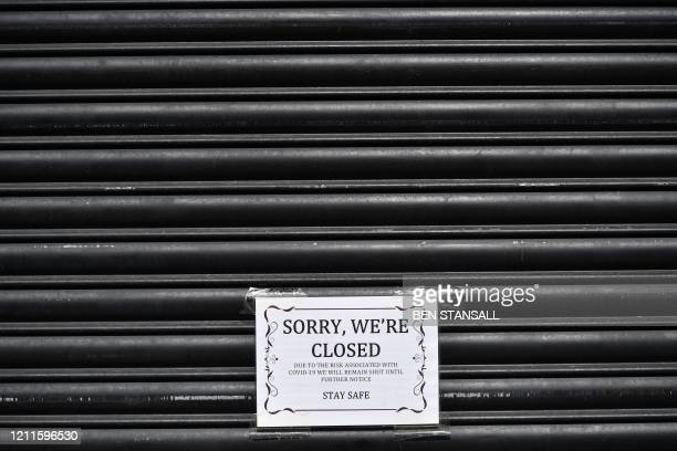 Sign informs customers that a shop is is closed in the London borough of Newham, east London, on May 2 as life in Britain continues during the...