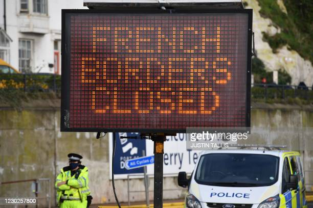 Sign informs drivers that the French border crossing is closed at the cordoned entrance to the ferry terminal at the Port of Dover in Kent, south...