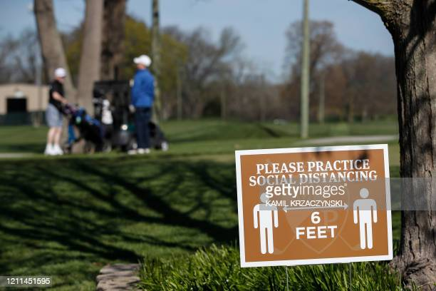 TOPSHOT A sign informs golfers to practice social distancing at the Mt Prospect Golf Club on May 1 2020 in Mt Prospect Illinois Under Illinois...