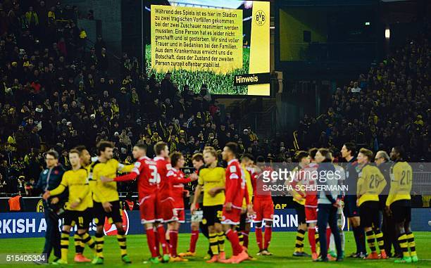 A sign informs of the death of a fan during the German first division Bundesliga football match Borussia Dortmund v 1 FSV Mainz 05 in Dortmund on...