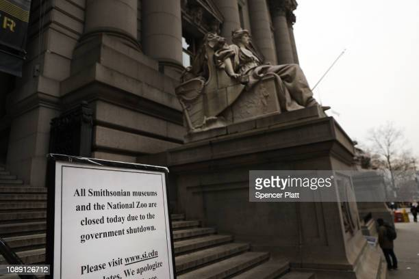 A sign informs visitors that the Smithsonian Institution's National Museum of the American Indian is closed due to the government shutdown on January...
