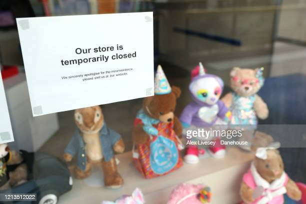 Sign inside a shop in the Trafford Centre shopping complex is seen as the UK adjusts to life under the Coronavirus pandemic on March 19, 2020 in...