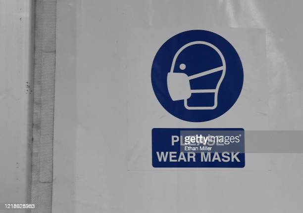 Sign inside a tent reminds people to wear masks at the joint Clark County-City of Las Vegas ISO-Q Complex for the homeless that was constructed in...
