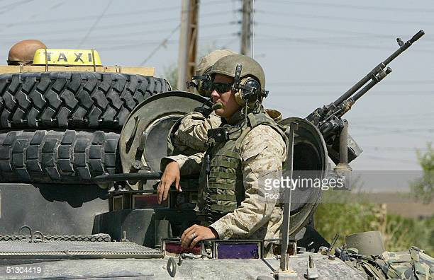 A TAXI sign is attached to a US Marines armored vehicle patrolling on September 14 2004 in the Iraqi Holy city of Najaf Weeks of battles between the...