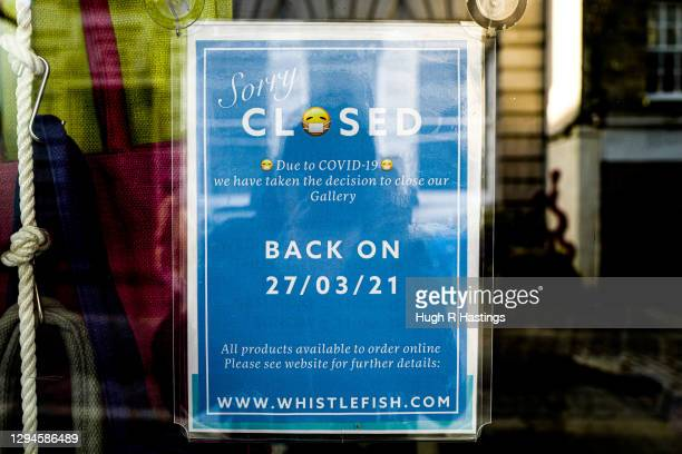 Sign is displayed at a closed retail outlet showing it will not re-open until March, on January 5, 2021 in Falmouth, United Kingdom. The British...