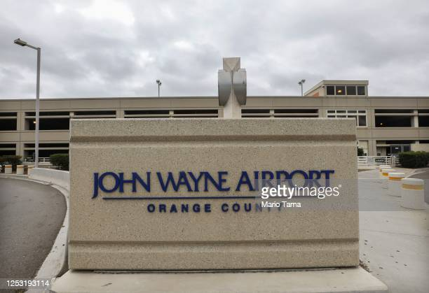 A sign is displayed at John Wayne Airport located in Orange County on June 28 2020 in Santa Ana California Orange County Democrats are calling for...