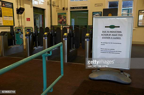 A sign is displayed at Selhurst train station showing it is closed due to industrial action in London on December 14 2016 Hundreds of thousands of...