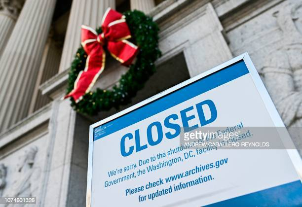 Sign is displayed at the National Archives building that is closed because of a US government shutdown in Washington, DC, on December 22, 2018. - The...