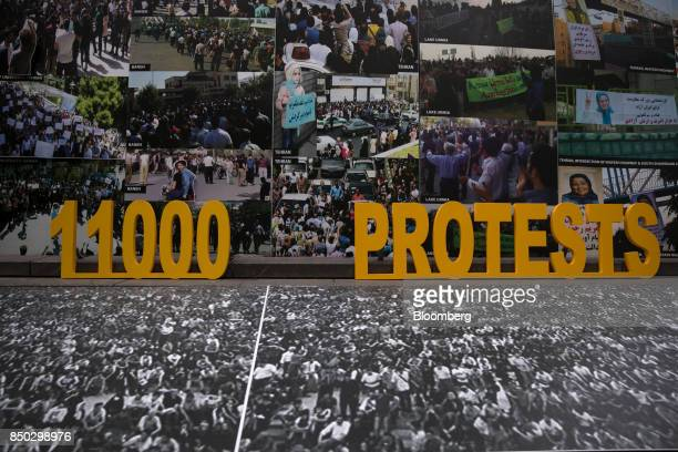 A sign is displayed during a protest against Hassan Rouhani Iran's president not pictured outside the UN General Assembly meeting in New York US on...
