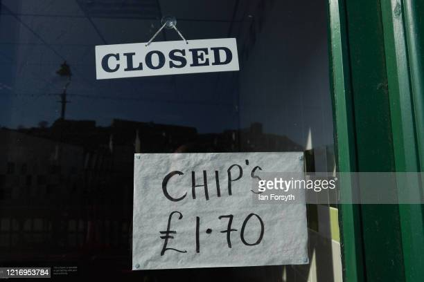 Sign is displayed in a chip shop window as the streets of Whitby remain empty of visitors as they observe the guidelines during the Coronavirus...