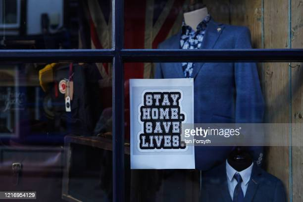"Sign is displayed in a shop window to ""Stay Home, Safe Lives"" during the Coronavirus pandemic lockdown on April 05, 2020 in Whitby, United Kingdom...."